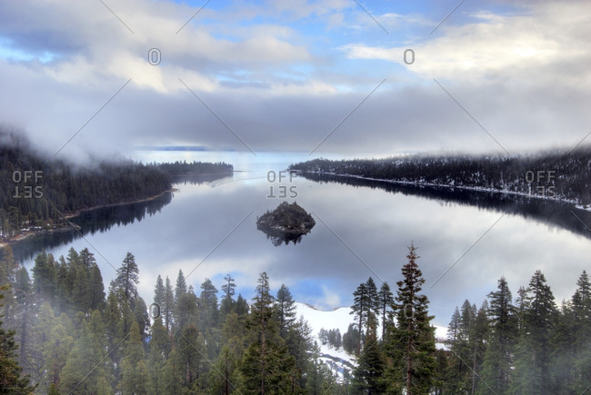 Clouds and mist cover Emerald Bay and Lake Tahoe in the winter, CA.