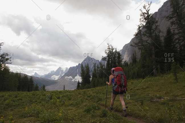 A female backpacker in her early thirties hiking the Rockwall Trail, Kootenay National Park.