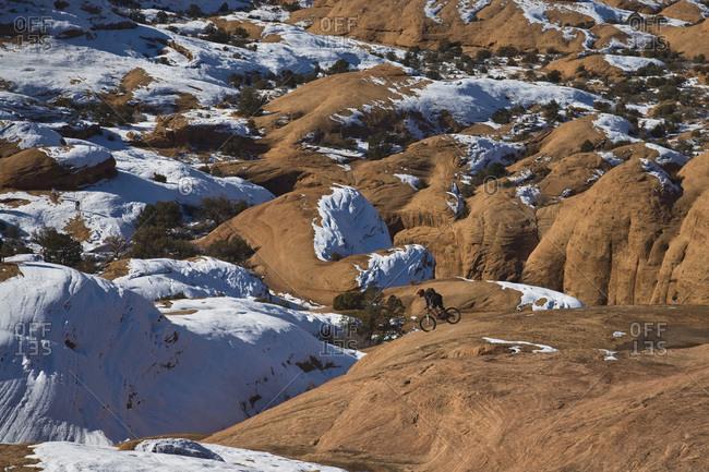 Mountain biker riding on slickrock in Moab, Utah.