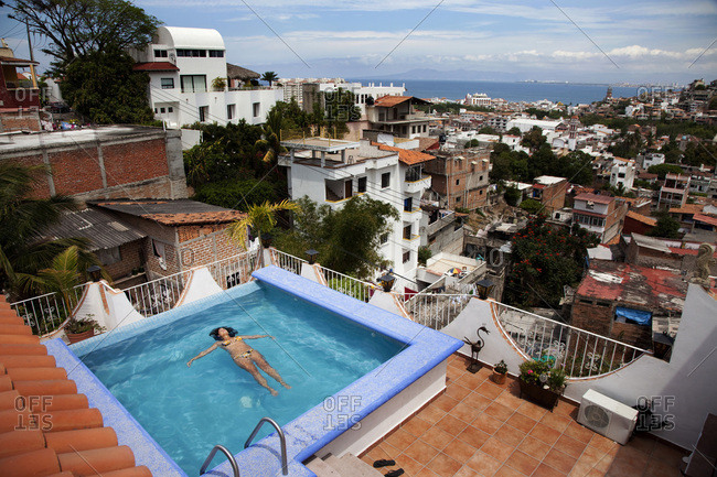 A woman laying in a private pool at her home in Puerto Vallarta.