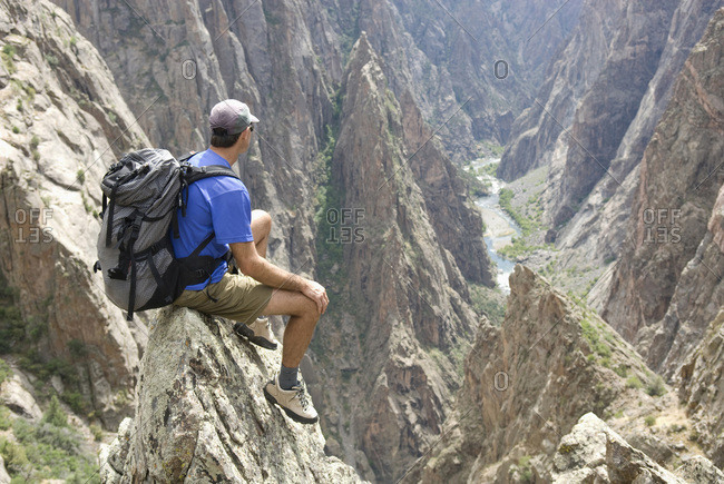Man hiking on the North Rim of the Black Canyon of the Gunnison, Colorado.