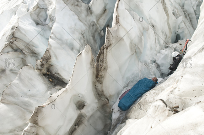 A woman sleeping in an icy crevasse, Mount Baker Wilderness, Bellingham, Washington.