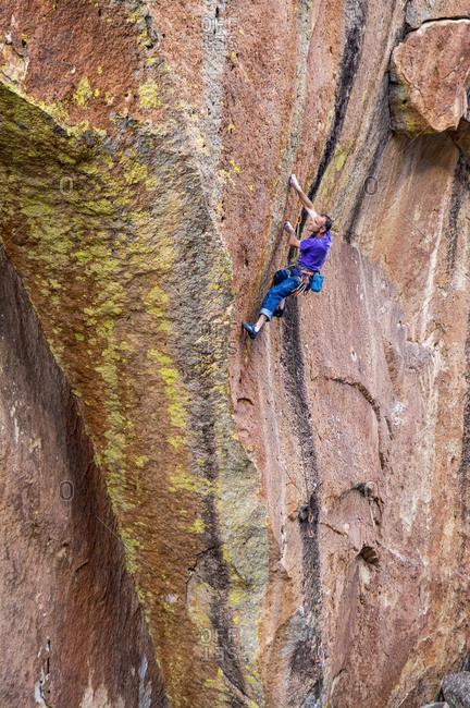 A man rock climbing at the Horn, Henry Mountains, Hanksville, Utah.