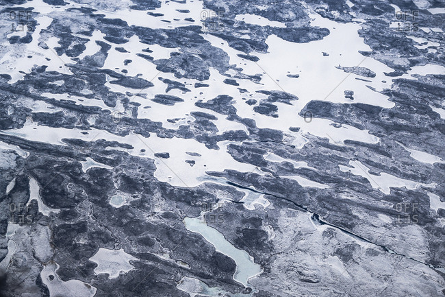 Aerial Image of Black Carbon Soot on Ice and Rock over the landscape of the Canadian Arctic.
