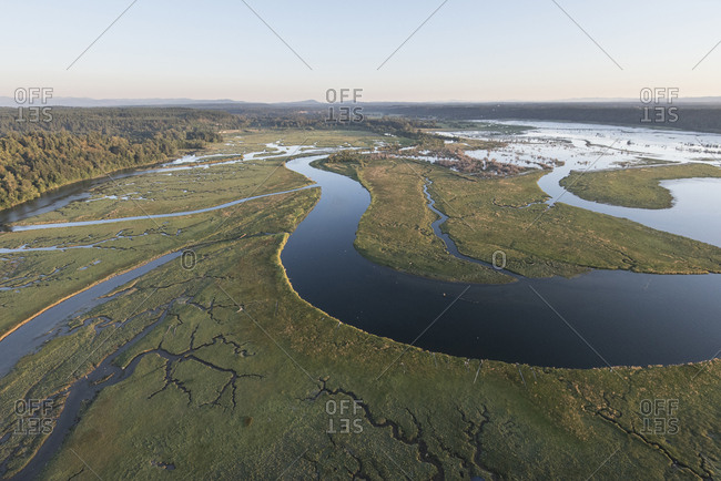 An aerial view of the river delta at Nisqually Wildlife Refuge at low tide at sunset.