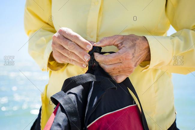 Woman adjusting a life vest strap