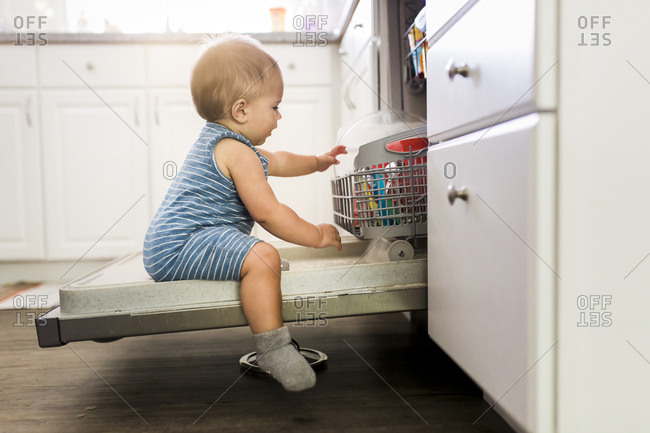 Toddler opening dishwasher
