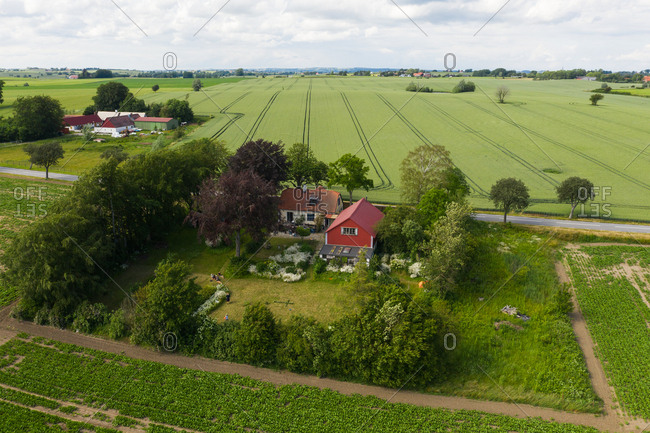 Elevated view of green fields and country home
