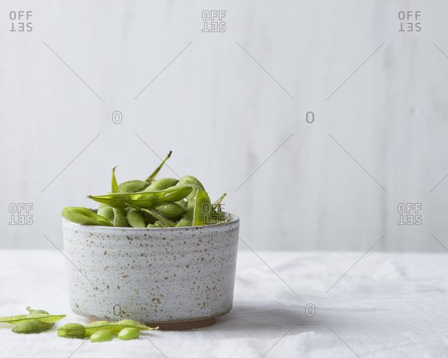 Edamame beans in speckled ceramic bowl