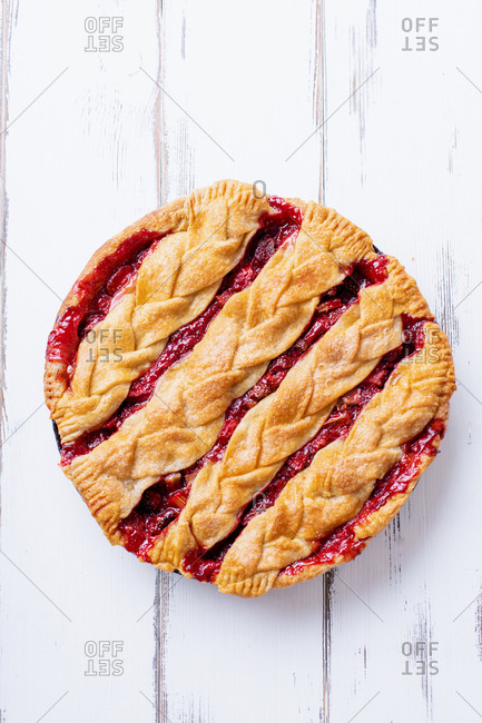 Rhubarb strawberry pie decorated with braided lattice