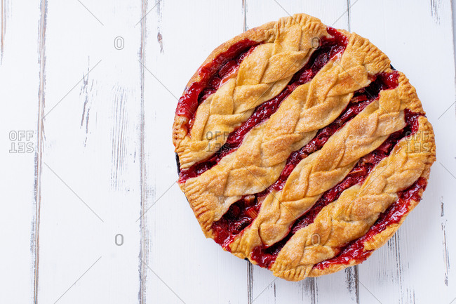 Overhead view of rhubarb strawberry pie decorated with braided lattice