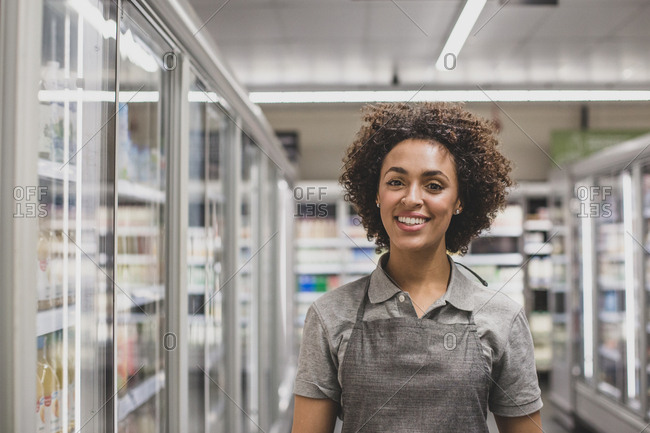 Portrait of grocery store sales assistant