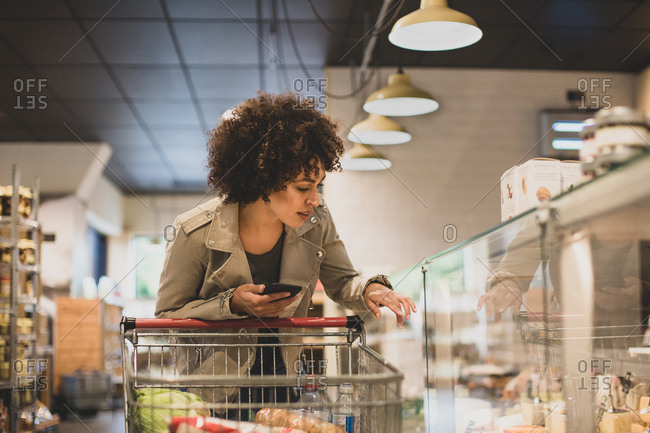 African American shopper at deli counter in a grocery store