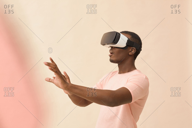 African American man using VR headset waist up horizontal shot