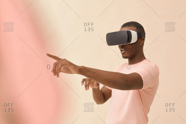 Portrait of young man wrapped up in virtual reality