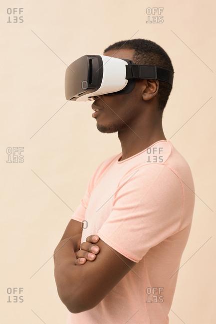 Black male model wearing VR glasses