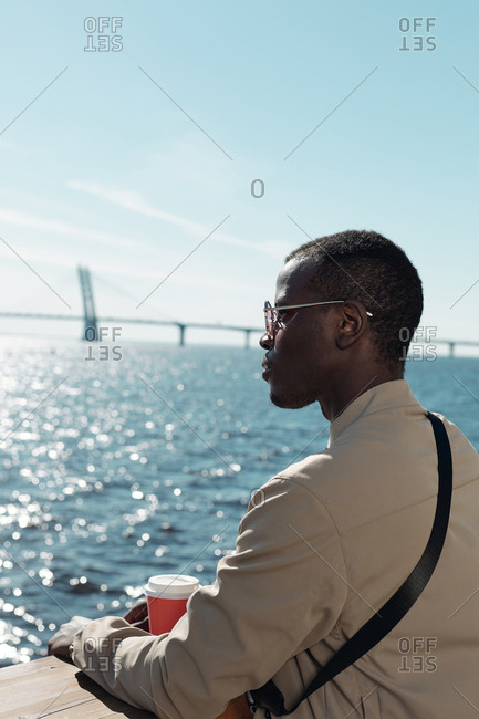 Young African American man looking at beautiful sea