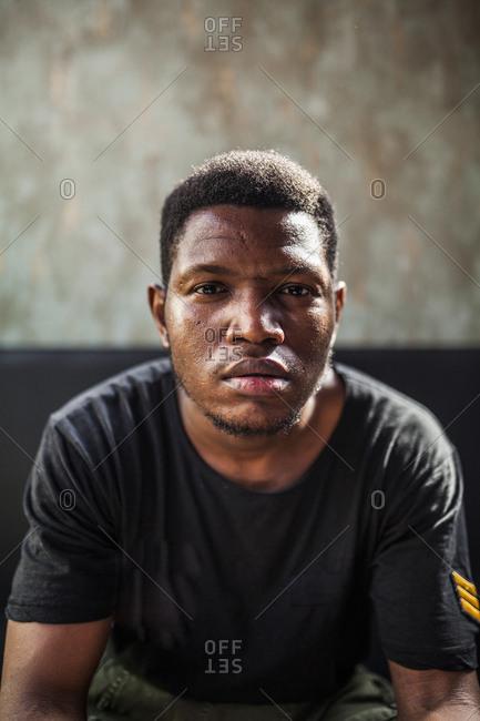Portrait of young black man