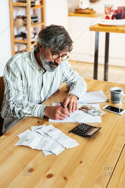 Mature man working at a home office