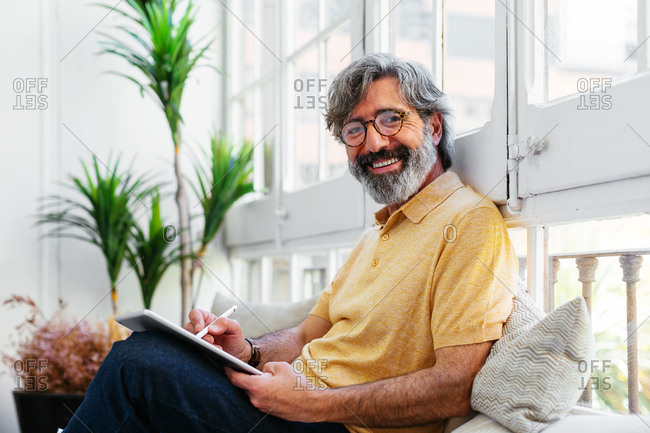 Mature man using a tablet at a home office