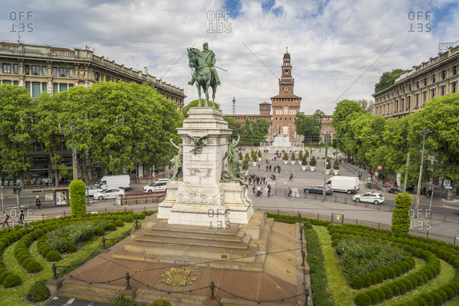 April 18, 2017: Italy, Lombardy, Milan . Largo Cairoli, equestrian monument to Giuseppe Garibaldi  made in 1895 by the artist Ettore Ximenes and the architect Augusto Guidini, on the background Castello Sforzesco (built in the 15th century by Francesco Sforza, Duke of Milan)