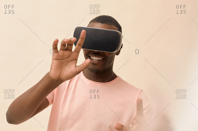 Studio portrait of young man wearing VR headset
