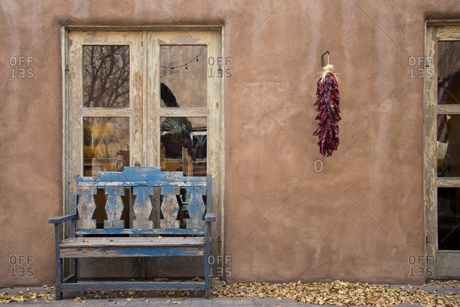 Old bench in front of home in Santa Fe, New Mexico