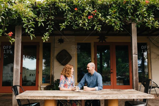 Pregnant couple enjoying tea outdoors