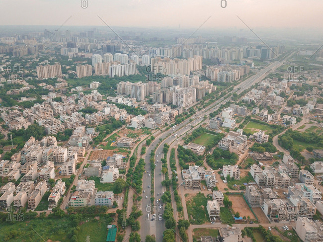 Aerial view of cars passing through a 2 way in urbanized gurgaon sector 34, delhi ncr, India.