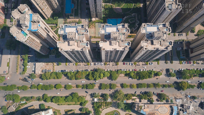 Top down aerial view of multistoreys buildings of ATS society by the main road in day light, Indrapuram, Delhi ncr, India.