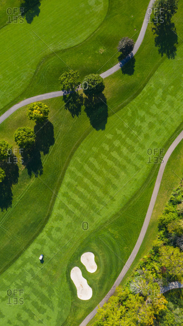 October 3, 2018: Aerial view of a golf course fairway and sand traps in autumn creating an abstract looking perspective at Arrowhead Golf Course in Wheaton, IL