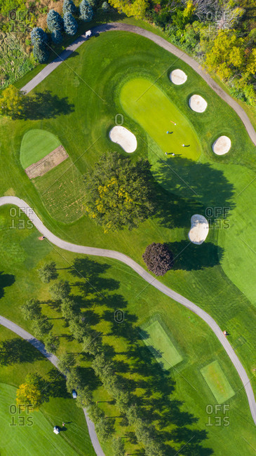 October 3, 2018: Aerial view of a golf course fairway and sand traps in autumn creating an abstract looking perspective at Arrowhead Golf Course in Wheaton, ILUSA