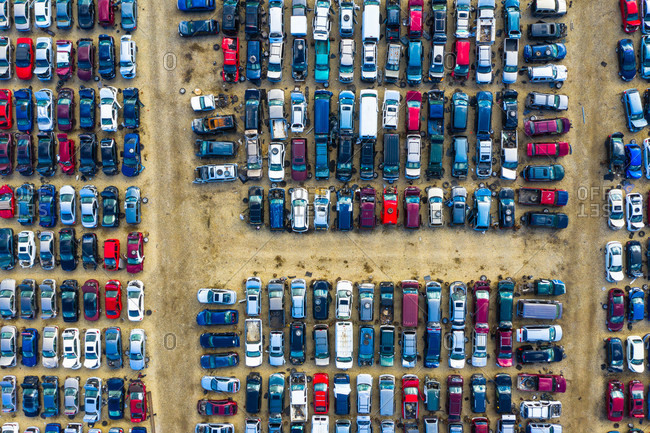 Aerial view of rows of old cars that have served, assembled in a junk yard waiting to be recycled for their reusable parts, Aurora, IL, USA.
