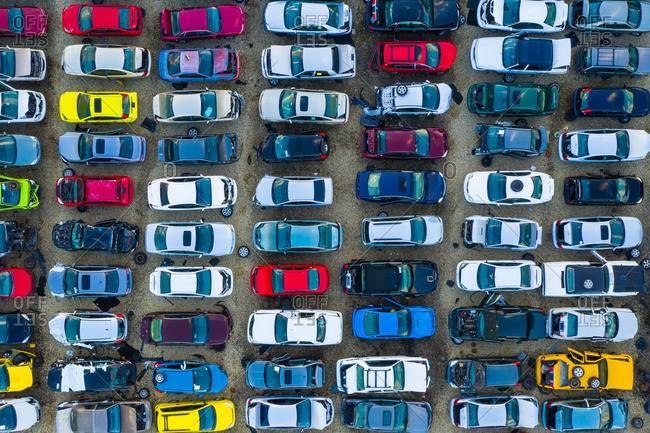March 17, 2019: Aerial view of rows of old cars that have served, assembled in a junk yard waiting to be recycled for their reusable parts, Aurora, IL, USA.