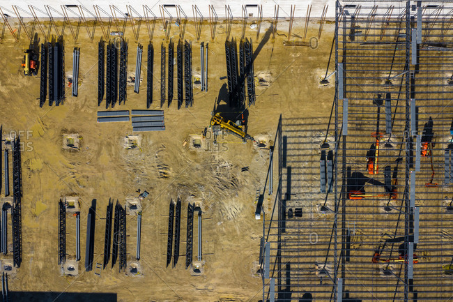 Aerial view of a construction site of a manufacturing facility in early morning light in Lisle, IL, USA