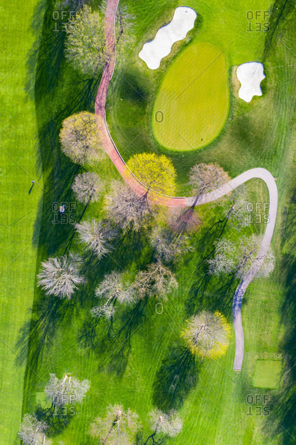 April 21, 2019: Aerial view of a golf course fairway and sand traps in early spring creating an abstract looking perspective at the Naperville Country Club in Napervile, ILUSA