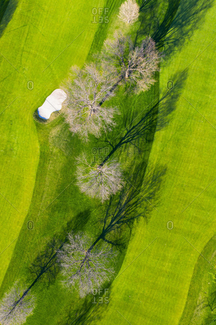 April 21, 2019: Aerial view of a golf course fairway and sand traps in early spring creatingg an abstract looking perspective at the Naperville Country Club in Napervile, IL.