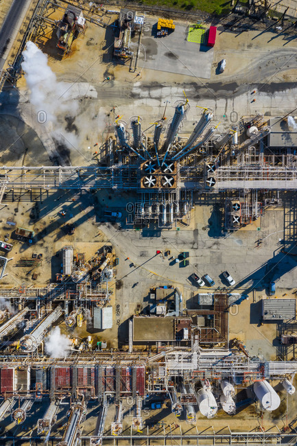LEMONT, IL, USAMAY 13, 2019:  Aerial view of a petro chemical processing plant and storage facilities in early morning light.