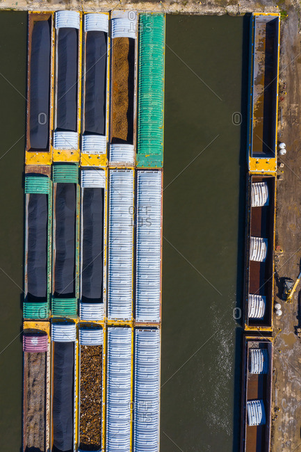 Aerial view of freight barges at a freight harbour on the Des Plaines River in Lemont, IL