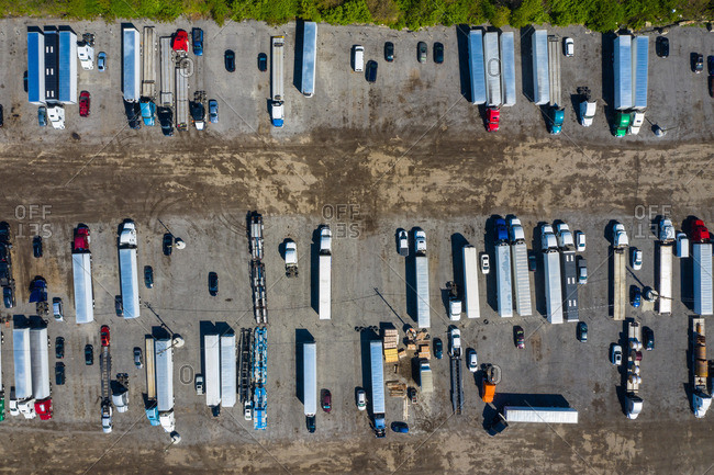 Aerial view of parked semi trucks and cars at a parking lot in Romeoville, ILUSA
