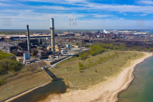 BURNS HARBOR, INDIANA, USAMAY 14, 2019: Aerial view of a modern steel producing facility on the shores of Lake Michigan in Indiana, USA
