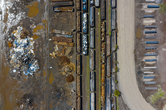 Aerial view of rail road cars, scrap metals and finished steel products at a modern steel producing facility on the shores of Lake Michigan in Indiana.