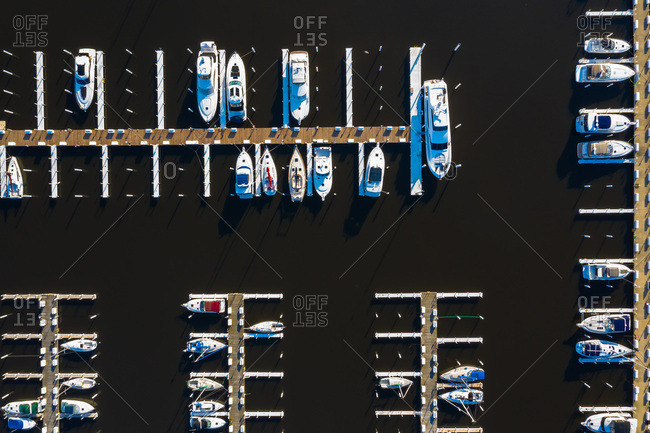 Aerial view of yachts and sailboats in late afternoon sunlight during early spring at a yacht harbour in Michigan City, IN in the United States