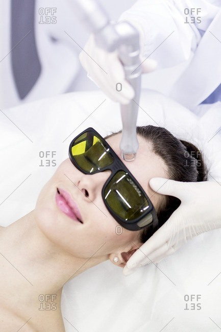 Beauty technician using laser treatment. This treatment is used to treat scars, wrinkles and stretch marks, but also for pigmentation removal.