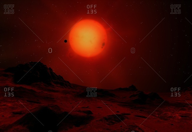 Illustration of a red dwarf star seen from the surface of an orbiting world. Red dwarfs are the most common stars in the universe. Like the Sun they are main-sequence stars, burning hydrogen, but substantially cooler, dimmer; redder and smaller. Proxima Centauri and Barnard's Star are well-known examples.