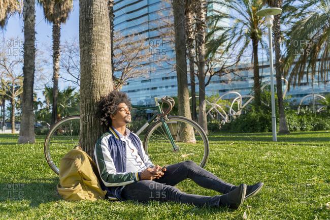 Casual businessman taking a break in urban park- Barcelona- Spain