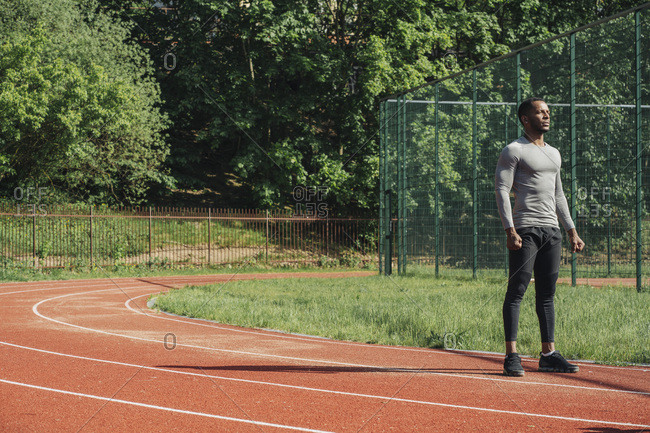 Sportsman standing on racetrack