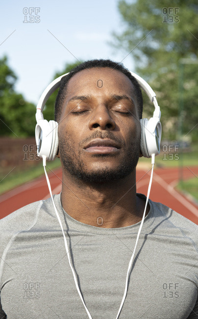 Sportsman listening to the music at racetrack