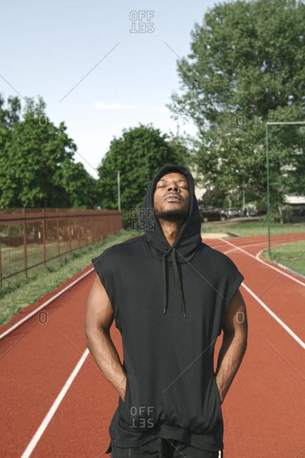 Portrait of sportsman wearing black hoodie shirt