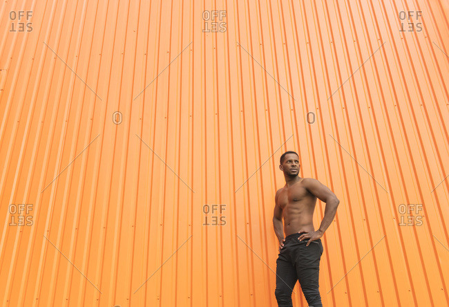 Portrait of athlete in front of an  orange wall